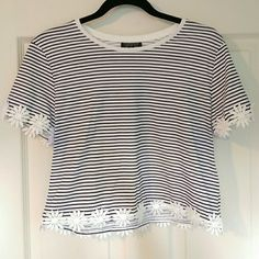 Topshop Crop Top This crop top is perfect for many different occasions. Lunch, casual dinner, errands, music festivals, anything! The daisy detail makes it ideal for Spring and Summer! Topshop Tops Crop Tops