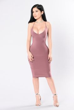 - Available in Red Bean, Black, Slate Blue and White - Double Layer Tank Dress - Spaghetti Strap - Deep V Neckline - Midi Length - Fitted - Made in USA - 96% Polyester 4% Spandex http://amzn.to/2rWj5Ft