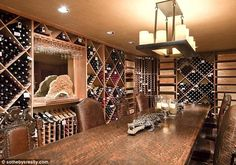 Snap it up: The dining room, lined with hundreds of wine bottles, also comes with a crocodile centerpiece