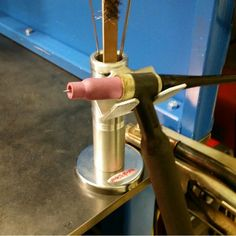 .Bench mounted welder handpiece holder.