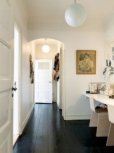 LOVE the dark floors and white walls and dark hardware