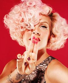 """Pink dressed as Marilyn Monroe (the symbol of Kitten programming) with one eye hidden and mouth """"shushed"""" by her hand. Sigh."""
