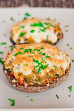 stuffed portobello mushrooms with bell pepper, spinach, garlic, tomatoes, goat cheese, mozzarella, and bread crumbs....