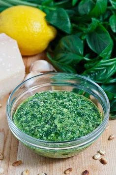 Basil Pesto - Ingredients: 1 cup basil (packed) 1 clove garlic 2 tablespoons pine nuts (toasted) 1/4 cup parmigiano-reggiano (grated) 3 tablespoons olive oil lemon juice to taste (optional) salt and pepper to taste  Directions: 1. Place everything into a food processor and blend.