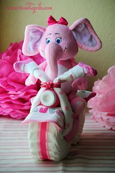 Very Cute Diaper Motorcylce Centerpiece for a baby shower - just a little twist on the diaper cakes I see everywhere now.