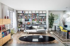 Living room with books... Colorful and full of light.