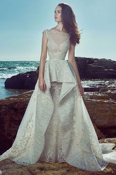 The #Spring2017 collection from @ZUHAIR MURAD is filled with princess-style gowns and sheer-panelled sheaths that fans of his line are sure to fawn over. See more on WedLuxe.com | WedLuxe Magazine | #wedding #luxury #weddinginspiration #fashion #whitedress