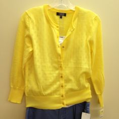 Sunny yellow cardigan with tonal polka dots.