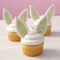 Bunny Ears Cupcakes from @michaelsstores. These clever and fun Bunny Ears Cupcakes are sweet picks to place in Easter baskets and serve on the Easter dinner dessert table. Make them using Wilton® White Candy Melts® Candy and Wilton® Spring Nonpareils!
