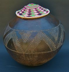 This spherical form vintage Beer Pot is decorated with compressed chevron bands throughout the center. It was made for storing and pouring the traditional sorghum beer popular in Zulu culture in South Africa.