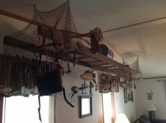 Opa's old rung ladder draped with fishing net then decorated with all of Opa's treasures from the boat house along with a few new things.