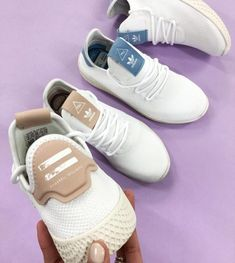 Created by the artist Pharrell Williams, the adidas Originals Pharrell Williams Tennis Hu sneakers in white and raw pink are a sports inspired street style classic.