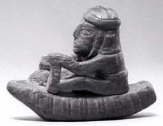 Wari figure in boat, 6th–9th century, Peru, Wood, paint