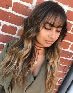 Long Layered Hairstyle With Light Bangs