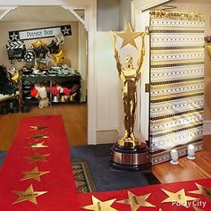 A bigger-than-life award statue standup cutout is the perfect sidekick for your TV at an Oscars watch party or movie party.
