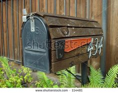 American mailbox covered with wood with flag down
