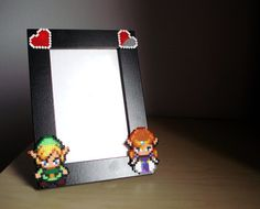 Hey, I found this really awesome Etsy listing at http://www.etsy.com/listing/107901840/legend-of-zelda-photo-frame-black