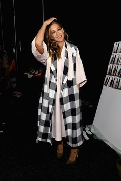Pin for Later: The Stars Continue to Catch Our Eye as Fashion Month Moves Along Sarah Jessica Parker at NYFW Carrie Bradshaw may have had her moment on the runway, but SJP was seen in the audience at Tome, wearing an extralong scarf over her coat.