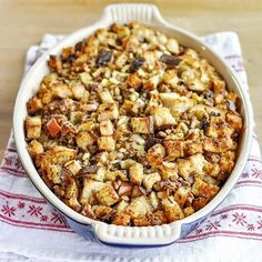 Anyone else here think that the stuffing is the best part of Thanksgiving dinner? I love its mix of textures and flavors — crunchy roasted nuts with soft broth-soaked bread and chewy morsels of spiced sausage. Oh mama, that's good stuff! As the self-designated stuffing-maker in our house, I've tweaked and tested my recipe over the years until finally settling on this one easy method.