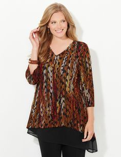 Feather Flow Top | Catherines Our stylish top features an abstract print that drifts all over the textured, stretch fabric. A sheer inset at the hem adds interest and creates a flowing finish. V-neckline. Three-quarter sleeves. Asymmetrical hem that is longer on one side. Catherines tops are perfectly proportioned for the plus size woman. #catherines #plussizefashion #fallfashion