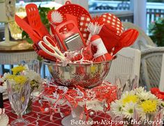 Colander filled with coordinating kitchen utensils from the blog BNOTP: Bridal Shower Tablescape