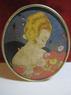 Gorgeous 1920's Luxor Encharma Face powder box profile of pretty lady holding bouquet of stylized art deco flowers