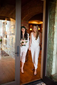 bride with maid of honor- becasue the JUMPSUIT!