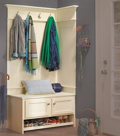 This entryway uses an unfinished over-the-microwave cabinet for its base. Plan is less than $6