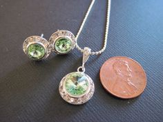 Small Chrysolite Green Swarovski Crystal Bridesmaid Jewelry Set/ Flower Girl / Bridesmaid Jewelry/ Wedding Jewelry/Junior Bridesmaid. $26.00, via Etsy.
