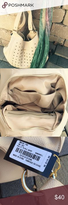 BEBE purse ✨Warm beige with gold grommets. Allot of pockets as well as a special pocket for your phone. A nice size and not to deep you loose everything, if you like a purse that works for you by keeping things organized- you will like adding this to your collection. bebe Bags Shoulder Bags