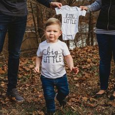 Pregnancy announcement with big brother, sibling #pregnancyannouncement, #pregnancyphotography, onesies for siblings, sibling style // #tbeapparel