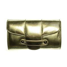 Emeline Coates Bond Street Leather Clutch (1907710 BYR) ❤ liked on Polyvore featuring bags, handbags, clutches, golden, chain purse, genuine leather handbags, leather clutches, leather purses and real leather handbags