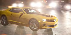 2013 Chevy Camaro SS Coupe in Rally Yellow with Black Rally Stripes.