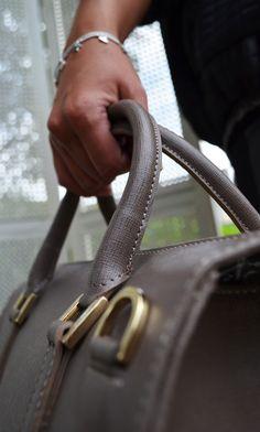 Bracelet Hult Quist £36, Real Leather Bag £85,