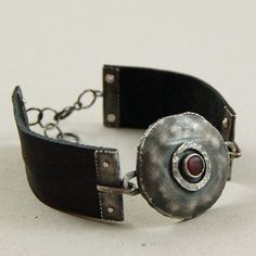 Good use of leather with hand-forged, riveted end pieces for attachments.