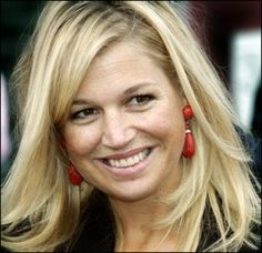 maxima with red statement earrings