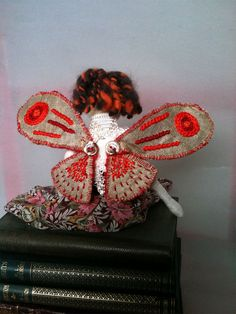 Moth is a mischievous fairy, sweet looking, but her eyes betray her wildness.  She is entirely had made by me. Her head is needle felted,