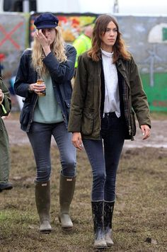 Alexa Chung street style: crumpled barbour jeans and wellies at Glastonbury festival June 2014