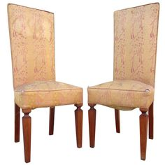 This pair of French Art Deco chairs in the manner of Andre Arbus features an elegant frame with a high back and tapered front legs.