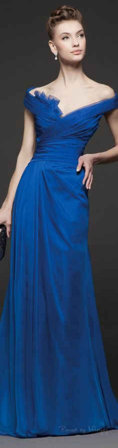 Pretty off the shoulder blue evening gown. We specialize in affordable replications of haute couture evening dresses for women of all sizes. www.dariuscordell.com