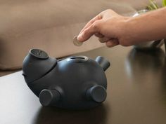 The Quirky Porkfolio Smart Piggy Bank is the world's smartest piggy bank. It wirelessly connects to an app on your mobile device so you can track your balance and set financial goals from afar.