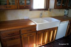 Ikea apron front sink image in use....your cabinets would be white though.