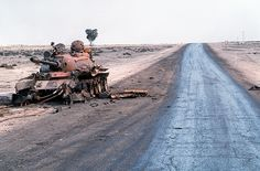Destroyed Iraqi T-55A main battle tank lies abandoned beside a road at ...