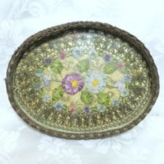Vintage Flapper vanity perfume tray with metallic lace and ribbon work. Ribbon work Pansy flowers with a wide border of gold metallic lace, under glass. This beautiful vanity tray is from the early 1900's to Flapper era.  All original condition. It is 10 inches x 7 1/2 inches and 1 1/4 inch deep.