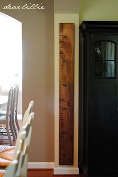 Turn a 2x4 into a large ruler for the wall, and record the height of your kids as they grow.