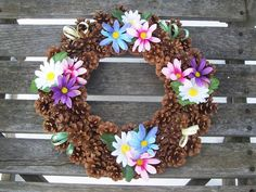 Pine Cone Wreath With Daisies, Pink, Purple, Blue, White.   www.etsy.com/shop/NaturesCraftSupply