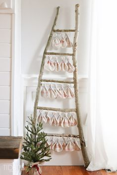 Christmas Countdown grain sack bags hanging on a log ladder. are the perfect addition to a woodsy or cottage Christmas theme. Pattern and tutorial available - by TIDBITS. Cottage Christmas, Christmas Bags, Christmas Countdown, All Things Christmas, Christmas Holidays, Christmas Crafts, Christmas Ideas, Holiday Ideas, Xmas