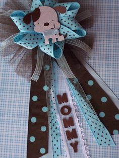 "Puppy Baby Shower ""Mommy"" CORSAGE in Brown and Blue. $18.00, via Etsy."