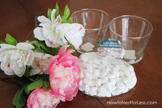 dollar store flower centerpieces, crafts, flowers, home decor, Supplies needed 3 short vases 2 bags of white rocks 3 bouquets of flowers