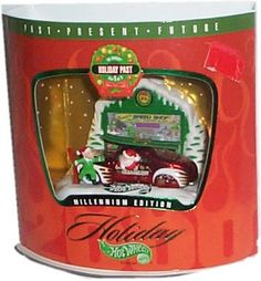 Hot Wheels Holiday (XMas) Millennium Edition: Past/Present/Future - Set 1 of 3 - Holiday Past - Tail Dragger Set by Mattel. $13.70. Holiday Past - Set 1 of 3 - Tail Dragger car. Approximately 1:64 scale vehicle. This is a special holiday (Christmas) Hot Wheels vehicle set designed for the adult collector.. Hot Wheels Holiday Millennium Edition - Past/Present/Future. This set includes car from the past with Santa behind the wheel, skis atop the car, elf by car fender. ...